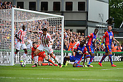 Stoke defender Geoff Cameron (20) clears his lines from Crystal Palace forward Cbristian Benteke (17) during the Premier League match between Crystal Palace and Stoke City at Selhurst Park, London, England on 18 September 2016. Photo by Jon Bromley.