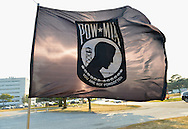 """East Meadow, New York, U.S. 11th September 2013. A POW MIA 'You Are Not Forgotten' flag is near the area of the Global War on Terror """"Wall of Remembrance"""" a traveling memorial on display in New York for the first time, at Eisenhower Park on the 12th Anniversary of the terrorist attacks of 9/11 2001."""