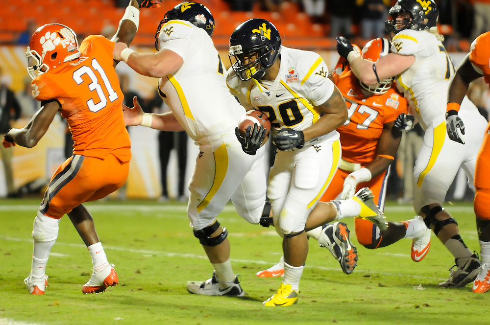 January 4, 2012: Shawne Alston of West Virginia scores a touchdown during the NCAA football game between the West Virginia Mountaineers and the Clemson Tigers at the 2012 Discover Orange Bowl at Sun Life Stadium in Miami Gardens, Florida.