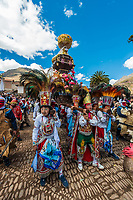 Pisac, Peru - July 16, 2013: Peruvian folklore at Virgen del Carmen parade in the peruvian Andes at Pisac Peru