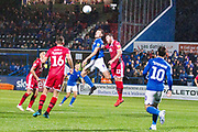 Macclesfield Town forward Joe Ironside in areal challenge with Morecambe forward Cole Stockton during the EFL Sky Bet League 2 match between Macclesfield Town and Morecambe at Moss Rose, Macclesfield, United Kingdom on 20 August 2019.