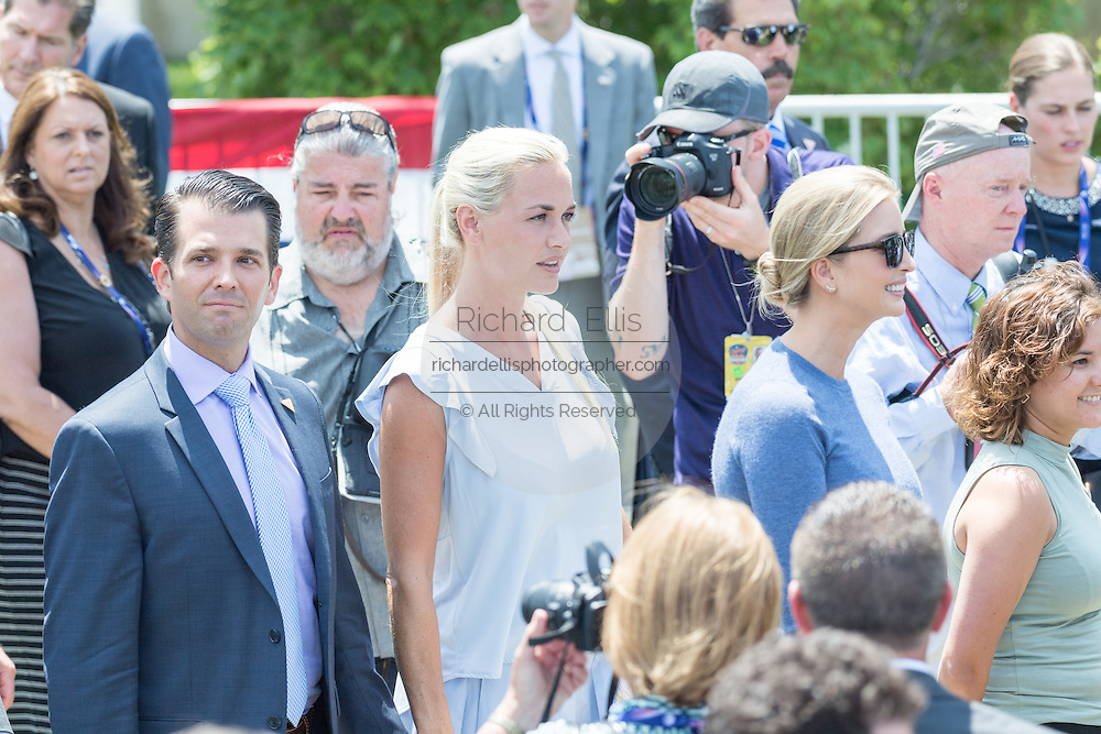 The children of GOP Presidential nominee Donald Trump walk to greet their father during his arrival by helicopter to the Republican National Convention July 20, 2016 in Cleveland, Ohio. Left to Right: Donald Trump, Jr., Vanessa Trump and Ivanka Trump.