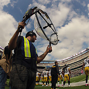 A television sound man working during the New York Jets V Pittsburgh Steelers NFL regular season game at MetLife Stadium, East Rutherford, NJ, USA. 13th October 2013. Photo Tim Clayton
