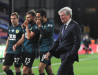 Football - 2019 / 2020 Premier League - Crystal Palace vs Burnley<br /> <br /> A dejected Palace Manager, Roy Hodgson after the match as Burnley players share a joke at Selhurst Park<br /> <br /> COLORSPORT/ANDREW COWIE