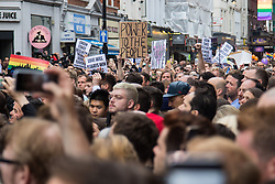 Old Compton Street, Soho, London, June 13th 2016. Thousands of LGBT people and their friends converge on Old Compton Street in London's Soho to remember the fifty lives lost in the attack on gay bar Pulse in Orlando, Florida. PICTURED: Part of the thousands-strong crowd with their defiant banners.