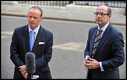 BBC News political editor Nick Robinson and Chief Political Correspondent Norman Smith (left) outside  No10 Downing on the day of the 1st Coalition Government Cabinet reshuffle, London, Tuesday September 4, 2012 Photo Andrew Parsons/i-Images