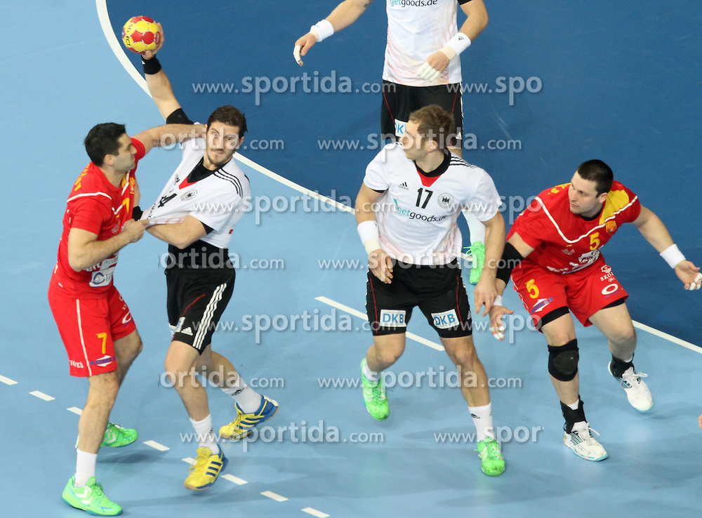 20.01.2013 Barcelona, Spain. IHF men's world championship, eighth.final. Picture show Oliver Roggisch  in action during game between Germany  vs FYRO Macedonia at Palau st Jordi / Sportida Photo Agency