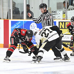 TRENTON, ON - Apr 22, 2016 -  Ontario Junior Hockey League game action between the against the Trenton Golden Hawks and the Georgetown Raiders. Game 5 of the Buckland Cup Championship Series, at the Duncan Memorial Gardens in Trenton, Ontario. Brendan Jacome #25 of the Georgetown Raiders battles for the puck with Danny Hanlon #27 of the Trenton Golden Hawks during the first period.<br /> (Photo by Andy Corneau / OJHL Images)