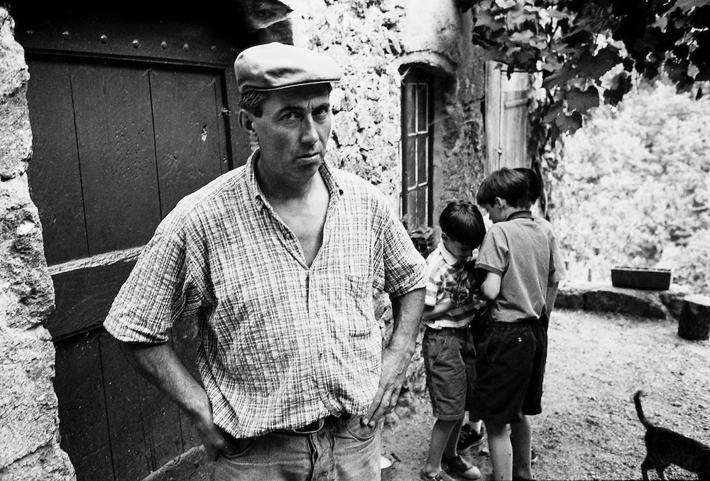 A farmer and cheesemaker with his children at their farm near the town of Lasalle in the Cévennes in the south of France.