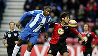 Photo: Paul Greenwood/Sportsbeat Images.<br />Wigan Athletic v Blackburn Rovers. The FA Barclays Premiership. 15/12/2007.<br />Wigan's Titus Bramble, (L) beats Blackburn's Roque Santa Cruz to the ball