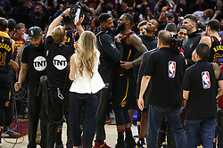April 25, 2018 - Cleveland, OH, USA - Cleveland Cavaliers forward LeBron James is flocked by teammates and media after scoring the game-winning 3-point shot against the Indiana Pacers in the fourth quarter of Game 5 on Wednesday, April 25, 2018, at Quicken Loans Arena in Cleveland. The Cleveland Cavaliers won, 98-95, for a 3-2 lead in the first-round NBA playoff series. (Credit Image: © Leah Klafczynski/TNS via ZUMA Wire)