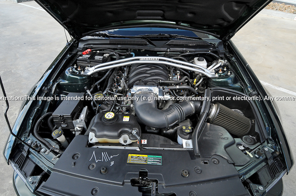 2008 Ford Mustang Bullitt - Highland Green Metallic paint.This car is build number #1764 out of 7700, this car was once owned by actor Tim Allen (from Home Improvement Fame) he has signed on the dash and inside the engine bay.Shot on location at William Adams Caterpillar & Clayton Business Park.Clayton, Victoria.27th of August 2011.(C) Joel Strickland Photographics.The Mustang Bullitt returned in February 2008, a special edition variant of the Mustang GT, the last version of which was produced in 2001. The 2008 Bullitt is reminiscent of the Dark Highland Green GT-390 fastback Mustang driven by Steve McQueen in the 1968 film of the same name. Available in Dark Highland Green or Black exterior paint and is stripped of its spoiler and GT fender emblems; the faux gas cap on the deck lid is replaced by a unique Bullitt version. The Mustang GT's standard fog light-equipped grille is replaced with the base V6 style grille without the running horse logo. Dark Argent Gray 18-inch cast-aluminum wheels are used with matching brake calipers and larger, 3.5 inch exhaust tips to replace the Mustang GT's standard 2.5 inch tips..Use information: This image is intended for Editorial use only (e.g. news or commentary, print or electronic). Any commercial or promotional use requires additional clearance.