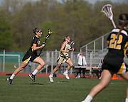 Katie Stankaitis carries the ball upfield during a game at Rush-Henrietta High School on Thursday, May 7, 2015.