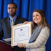 Rebecca Ryan, right, is presented with a Humanities Texas 2015 Outstanding Teaching of the Humanities Award by Jeremy Brown, left, at Leland College Preparatory Academy for Young Men, February 2, 2016.