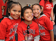 Megan June, 8, Taja June, 10, and Joan June, 7, pose for photographs while attending a luncheon with their father, Keith June of Tucson, at the NASA Wildcat Family Pride Weekend. June is a linguistics major at the University of Arizona, Tucson, Arizona, USA.