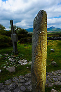 Dingle peninsula. Kilmalkedar monastery, an ogham stone. Ogham is an Early Medieval alphabet used primarily to write the Old Irish language. Founded in the seventh century, Kilmakedar is located on the Dingle Peninsula in County Kerry and is spread out over ten acres. The site contains a church, ogham stone, oratory, sundial, several cross-inscribed slabs, and two houses. It includes structures built in the Early Christian era through ones built in the fifteenth century. Although primarily a Christian site, it includes some pagan elements. Supposedly, it was founded by Saint Maolcethair, son of the King of Ulster, who died at this site in 636. He chose it because of its proximity to Mount Brandon, a pre-Christian religious symbol, and the pilgrim's track which leads to Mount Brandon passes through Kilmalkedar.