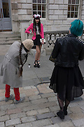A stylish woman poses for ywo fashionistas between catwalk shows on the second day of London Fashion Week.  London Fashion Week is one of the highest profile fashion events in the world. There are 50 or so catwalk shows on the official schedule as well as further 45+ show off schedule.