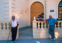 MALTA GOZO SANNAT JUL00 - Old men chat on the pavement prior to a Fiesta in Sannat, Gozo.. . jre/Photo by Jiri Rezac. . © Jiri Rezac 2000. . Tel:   +44 (0) 7050 110 417. Email: info@jirirezac.com. Web:   www.jirirezac.com