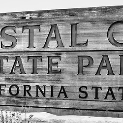 Crystal Cove State Park sign in Laguna Beach California in black and white. Crystal Cove State Park is a popular attraction in Orange County with beaches, walking trails and tide pools along the Pacific Ocean.
