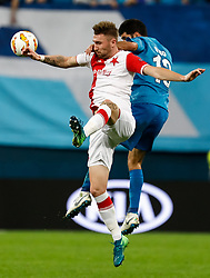 October 4, 2018 - Saint Petersburg, Russia - Luis Neto (R) of FC Zenit Saint Petersburg and Jaromir Zmrhal of SK Slavia Prague vie for a header during the Group C match of the UEFA Europa League between FC Zenit Saint Petersburg and SK Sparta Prague at Saint Petersburg Stadium on October 4, 2018 in Saint Petersburg, Russia. (Credit Image: © Mike Kireev/NurPhoto/ZUMA Press)