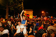 Paris, France. July 1st 2006..People celebrate on the Champs Elysees after France won against Brazil during their 1/4 finals game of the World Cup...