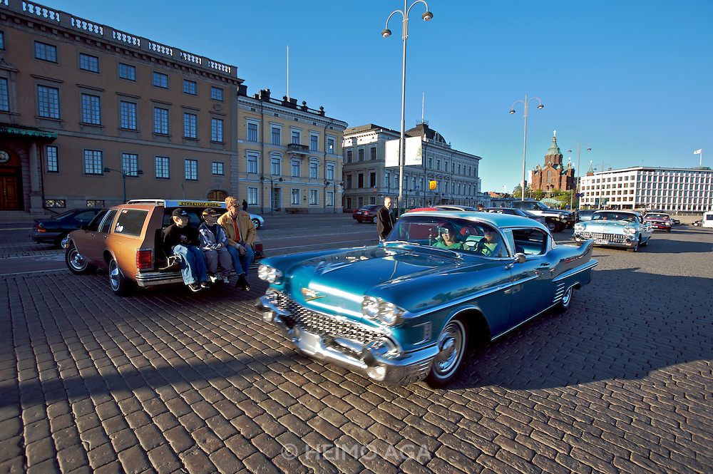 During summer from June to Septemper, every first Friday of the month is Vintage Car Cruising Night. Hundreds of classic American cars cruise around downtown Helsinki and meet at special places to have a good time, here at Kauppatori (Market Square), Uspenski orthodox cathedral in background. Cadillac Eldorado Coupe?s from the Fifties.