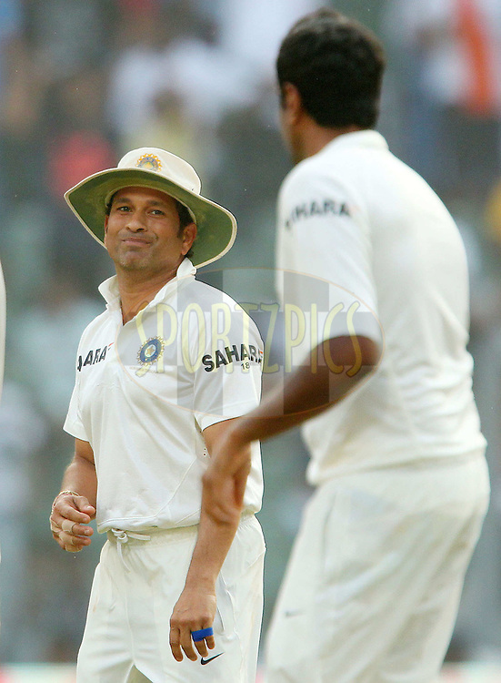 Sachin Tendulkar of India chats with Ravichandran Ashwin of India  during day two of the second Star Sports test match between India and The West Indies held at The Wankhede Stadium in Mumbai, India on the 15th November 2013<br /> <br /> This test match is the 200th test match for Sachin Tendulkar and his last for India.  After a career spanning more than 24yrs Sachin is retiring from cricket and this test match is his last appearance on the field of play.<br /> <br /> <br /> Photo by: Ron Gaunt - BCCI - SPORTZPICS<br /> <br /> Use of this image is subject to the terms and conditions as outlined by the BCCI. These terms can be found by following this link:<br /> <br /> http://sportzpics.photoshelter.com/gallery/BCCI-Image-Terms/G0000ahUVIIEBQ84/C0000whs75.ajndY