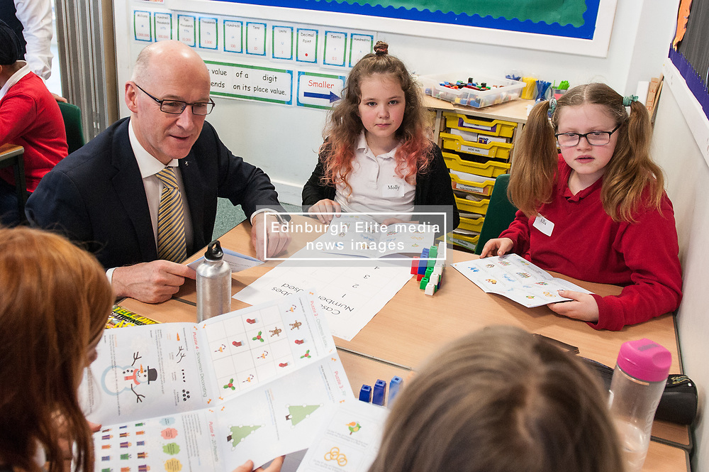 John Swinney launches Christmas Maths Challenge. Festive puzzles aimed at P6 pupils and their families, as part of a drive to encourage positivity towards maths were handed out to children at Towerbank Primary School Edinburgh by the Deputy First Minister John Swinney.<br /> <br /> <br /> © Jon Davey/ EEm