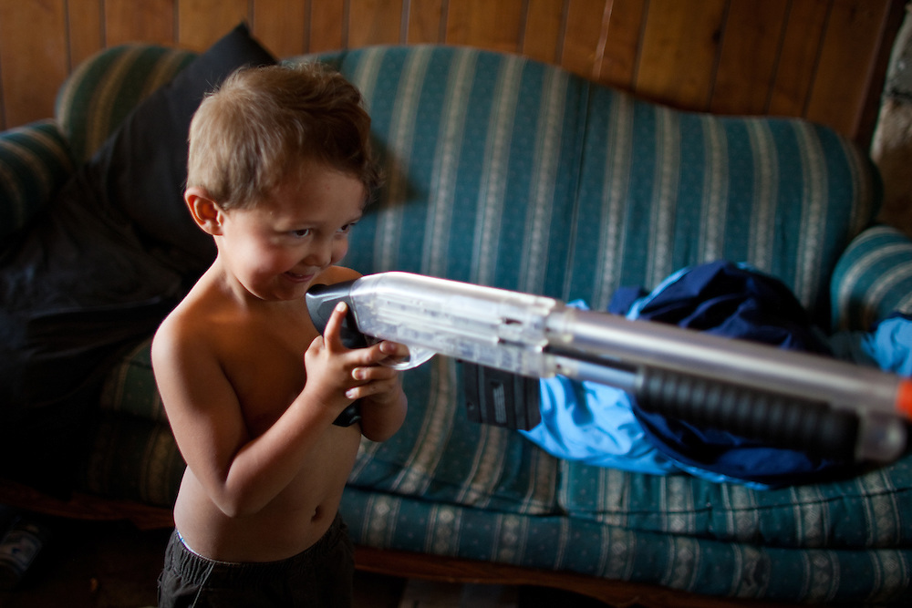Jojo shoots his toy gun with plastic pellets.