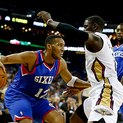 Nov 16, 2013; New Orleans, LA, USA; Philadelphia 76ers small forward Evan Turner (12) is guarded by New Orleans Pelicans point guard Jrue Holiday (11) during the first quarter of a game at New Orleans Arena. Mandatory Credit: Derick E. Hingle-USA TODAY Sports