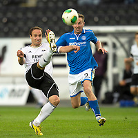 Rosenborg v St Johnstone....18.07.13  UEFA Europa League Qualifier.<br /> TORE REGINIUSSEN CLEARS FROM STEVEN MACLEAN<br /> Picture by Graeme Hart.<br /> Copyright Perthshire Picture Agency<br /> Tel: 01738 623350  Mobile: 07990 594431