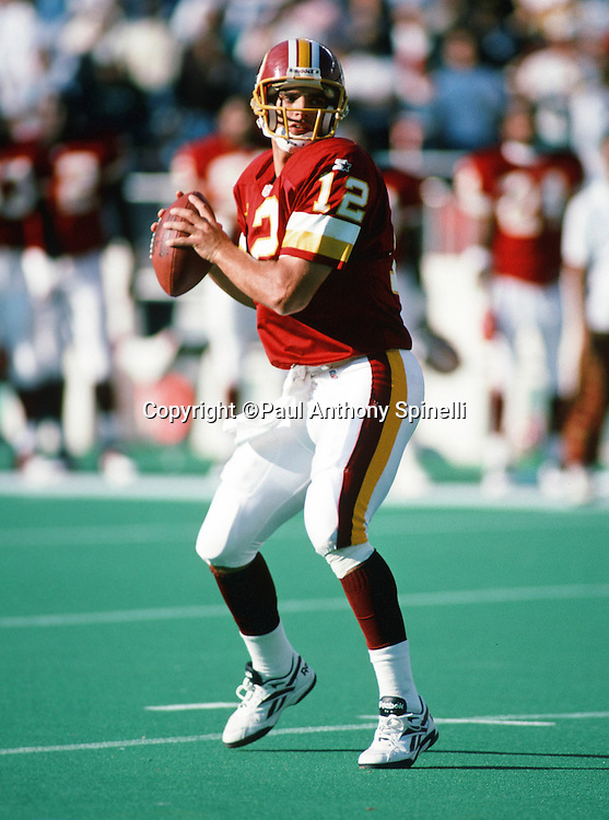 Washington Redskins quarterback Gus Frerotte (12) throws a pass during the NFL football game against the Philadelphia Eagles on Oct. 8, 1995 in Philadelphia. The Eagles won the game 37-34 in overtime. (©Paul Anthony Spinelli)