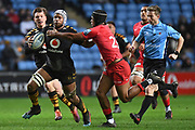 Wasps back row Nizaam Carr (8) evades the tackle of Saracens winger Ali Crossdale (23) during the Gallagher Premiership Rugby match between Wasps and Saracens at the Ricoh Arena, Coventry, England on 21 February 2020.