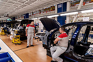 CASSINO, ITALY - NOVEMBER 24: Employees at work on the Assembly Lines where they assemble the Alfa Romeo Giulia in the Cassino Assembly Plant FCA Group on November 24, 2016 in Cassino, Italy. In this area new workstations designed to reduce fatigue and improve ergonomics have been introduced to support workers involved in the manual elements of assembly.
