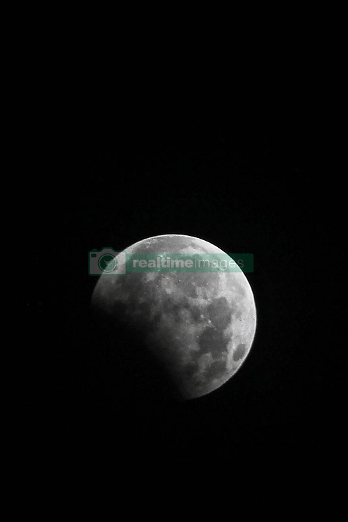 August 8, 2017 - Medan, North Sumatra, Indonesia - A full moon during the peak of the penumbral eclipse is seen from North Sumatra early August 8, 2017, Indonesia. The lunar eclipse occurs when the Moon passes directly behind the Earth into its umbra. This can happen only when the sun, earth, and moon are exactly aligned, or very close, with the Earth in the middle. There are three types - total, partial and penumbral. (Credit Image: © Ivan Damanik via ZUMA Wire)