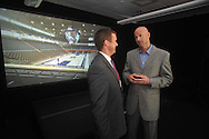 Danny White (left), executive director of the UMAA Foundation, and Mississippi head basketball coach Andy Kennedy talk in front of a screen showing a new basketball arena the university plans to build. The university announced a $150 million capital improvement campaign to build a new basketball arena and expand Vaught-Hemingway Stadium in Oxford, Miss. on Tuesday, August 9, 2011. (AP Photo/Oxford Eagle, Bruce Newman)