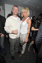 JENNY FROST and her husband DOMINIC THRUPP at a dinner hosted by Ruinart Champagne for Yasmin Mills at Nobu, Park Lane, London on rth May 2009.