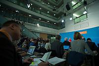 20 NOV 2016, BERLIN/GERMANY:<br /> Angela Merkel, CDU, Bundeskanzlerin, und im ersten Stock Mitglieder des Bundesvorstandes und Mitarbeiter, Pressekonferenz mit Bekanntgabe Ihrer erneuten Kandidatur fuer das Amt der Bundeskanzlerin, Klausurtagung des CDU-Bundesvorstandes, Konrad-Adenauer-Haus<br /> IMAGE: 20161120-01-012