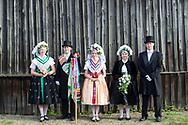 Vivien (Ehrenjungfrau), David (Hochzeitslader), Tina (Brautjungfer), Tina (Brautjungfer), Christin (Bride)  and Jens (Groom) wearing the Traditional Sorbian Costume in Saspow near Cottbus, Germany on June 9, 2017