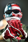 An Arizona Cardinals fan sports red, white, and blue painted face in honor of the American flag on Veteran's Day during the Arizona Cardinals 2017 NFL week 10 regular season football game against the Seattle Seahawks, Thursday, Nov. 9, 2017 in Glendale, Ariz. The Seahawks won the game 22-16. (©Paul Anthony Spinelli)