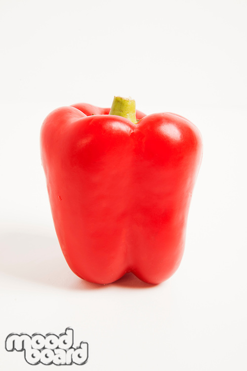 Close-up of red bell pepper over white background