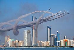 Al Fursan the aerobatics demonstration team of the United Arab Emirates Air Force display along Corniche waterfront in Abu Dhabi United Arab Emirates