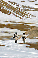 Simon Auclair -24 Kathryn Bywaters ñ 27 on a mission  for drilling a hole for sensors data next to Foxi Lake on Devon Island Canada on Monday, June 4, 2007..Mars flashline Mars arctic (FMARS)..On Devon Island in the high Canadian Arctic a group of sciences from the USA & Canada is gathering for four month to search watt human being can do on mars planet..The four month mission will be the first time that a simulated Mars mission has ever been conducted for such a long duration..The crow of volunteers includes some biologist geologist and other nether scientist researches...They chose Devon Island in Canada because it simulated the acclaim on the planet Mars, for getting the filling of being on Mars and to challenge the research and to make it close as they can to the conditions on the planet they wear spies suit and live isolated in the laboratory for four month..The man person that ran the project is Dr Robert Zabrin that believe that this project can lied to find ways to search for life on Mars and maybe to fined a way that human being will be able to live on the planet...This project is privet projects that cooperate with several universities around the world...