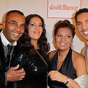 NLD/Amsterdam/20120204 - 30ste Verjaardag Richy Brown, Richy met vader gerald Brown en moeder Ann Vries en zus Raquel