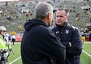 October 26 2013: Northwestern Wildcats head coach Pat Fitzgerald talks with Iowa Hawkeyes head coach Kirk Ferentz before the start of the NCAA football game between the Northwestern Wildcats and the Iowa Hawkeyes at Kinnick Stadium in Iowa City, Iowa on October 26, 2013. Iowa defeated Northwestern 17-10 in overtime.