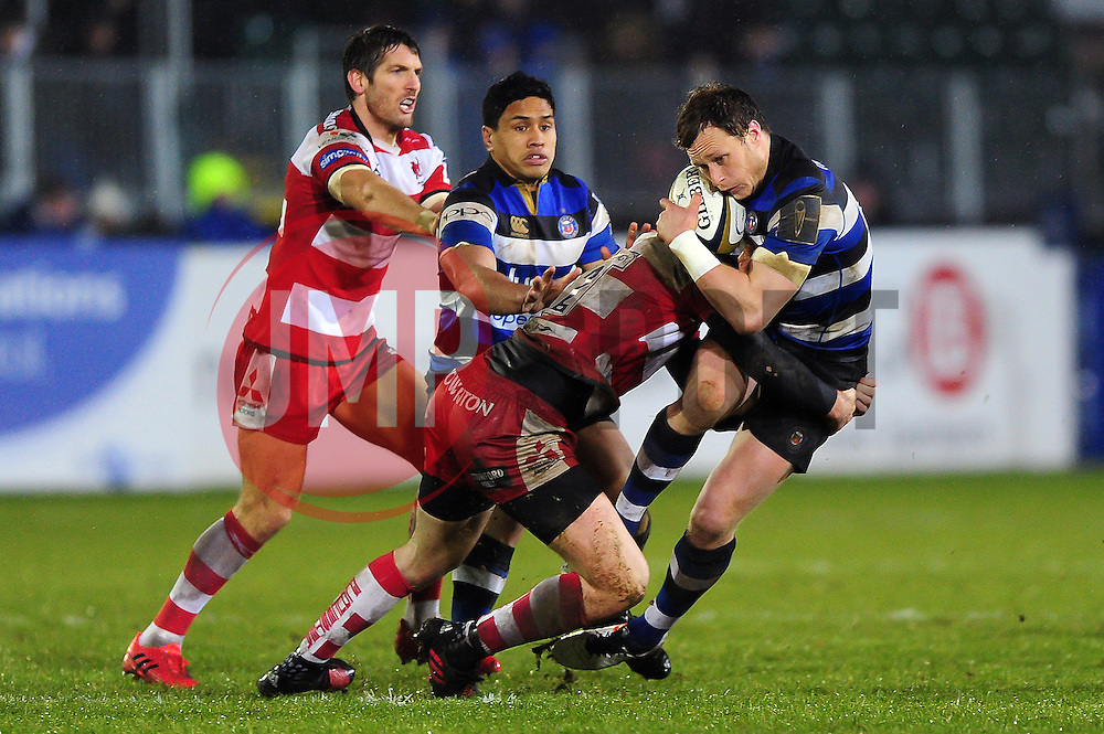 Jack Wilson of Bath Rugby is tackled in possession - Mandatory byline: Patrick Khachfe/JMP - 07966 386802 - 27/01/2017 - RUGBY UNION - The Recreation Ground - Bath, England - Bath Rugby v Gloucester Rugby - Anglo-Welsh Cup.