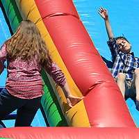 Nathaniel Boatman, 11, enjoys the inflatable slide set up at for Field Day on Monday at Milam in Tupelo.