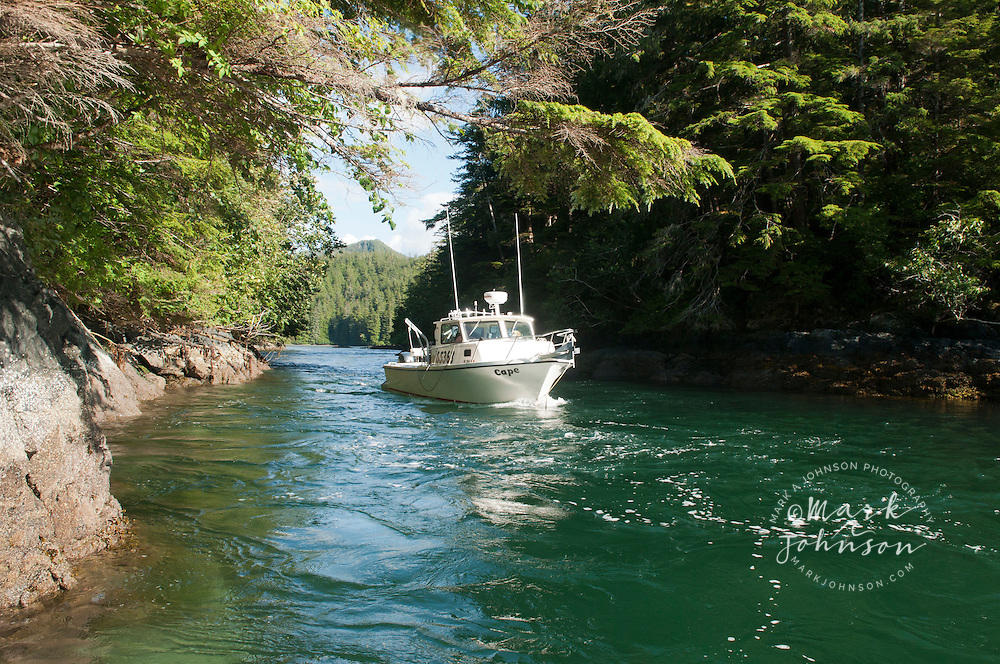 Boat in narrow channel between two islands, North Thorougfare, Sitka, Alaska