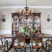 The dramatic dining room features venetian plaster on walls and ceiling. The  china in the breakfront  was inherited from Becky's mother.