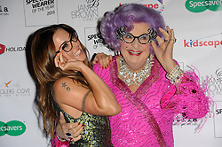 Specsavers Awards.<br /> (L-R) Mel C  & Dame Edna Everage attends the Specsavers Awards, held at the Royal Opera House, Covent garden, London, United Kingdom. Tuesday, 10th September 2013. Picture by Chris Joseph / i-Images